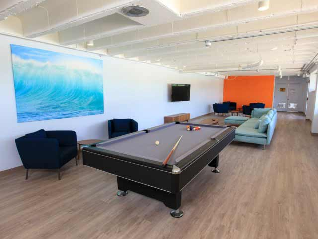 Relaxing community game room with pool table