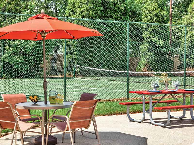 Picnic area and tennis courts at Cedar Brook Apartments