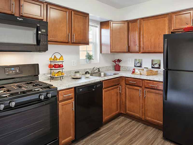 Upgraded kitchen with new cabinets and appliances at Fox Pointe Apartments