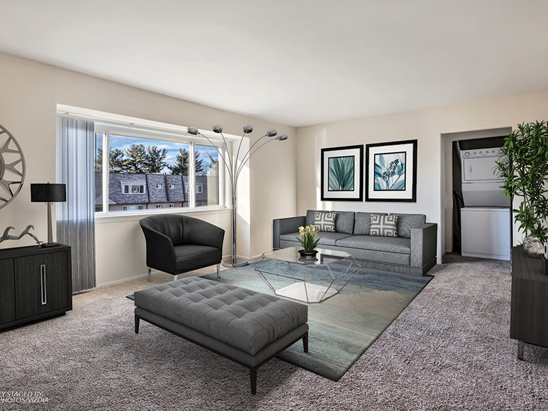 Spacious living room area at Franklin Commons Apartments