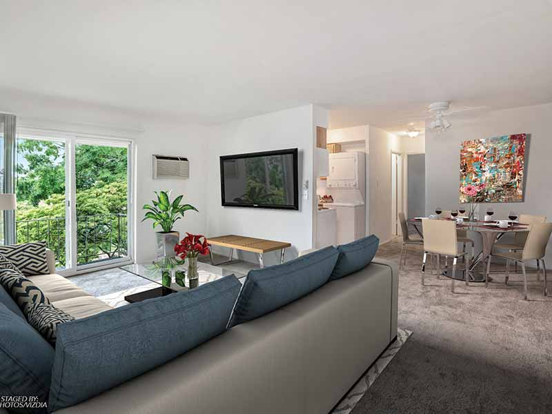 Modern living and dining room open floor plan at Lehigh Square Apartments