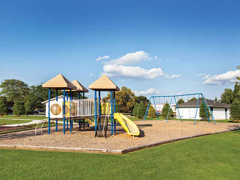 Community playground and swing sets at Liberty Point