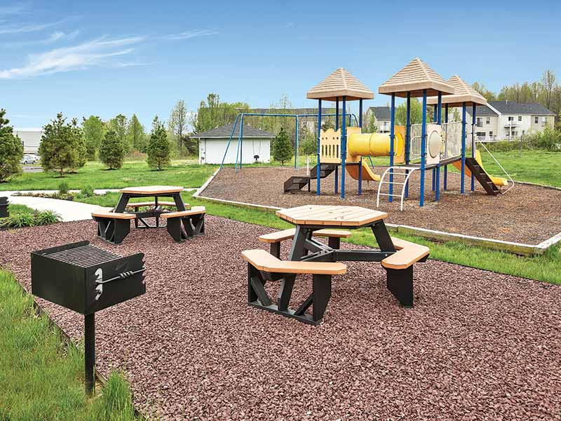 Community barbeque, picnic area, and playground at Liberty Pointe