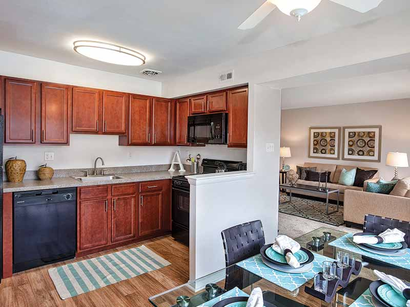 Upgraded kitchen and dining area with new appliances at Park Waverly